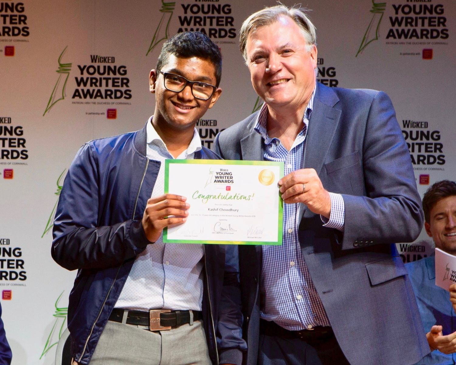 15-17 Category Winner Kashif Chowdhury with judge Ed Balls - Wicked Young Writer Awards 2018 Photo Credit: Ellie Kurttz