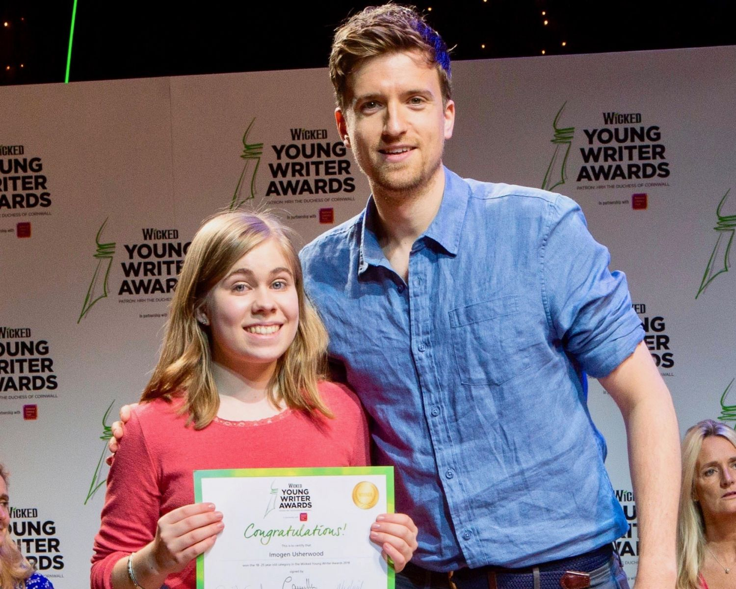18-25 Category Winner Imogen Usherwood with host Greg James - Wicked Young Writer Awards 2018 Photo Credit: Ellie Kurttz
