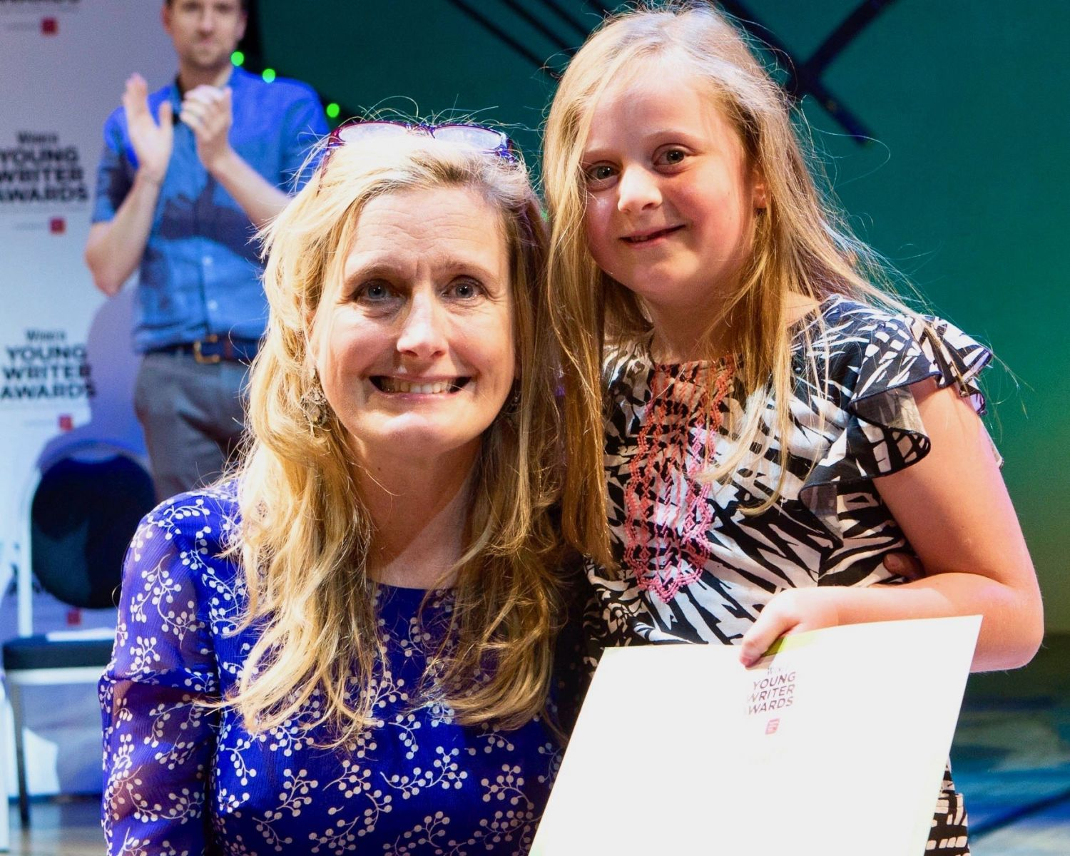 5-7 Category Winner Fern Brindle with Head Judge Cressida Cowell - Wicked Young Writer Awards 2018 Photo Credit: Ellie Kurttz